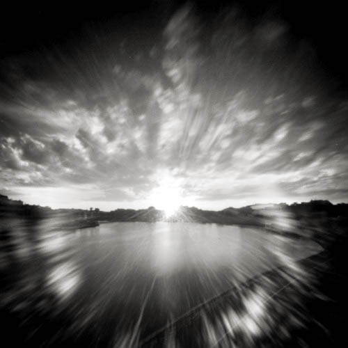 pinhole of sunset with flare